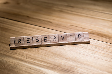 wooden reserved sign in restaurant Stock Photo