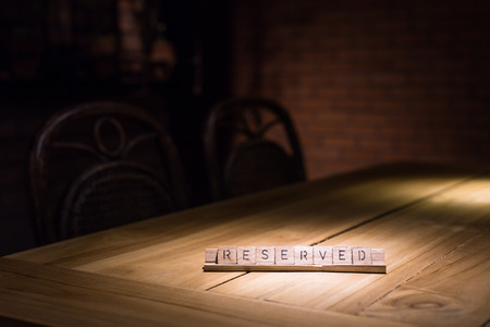 wooden reserved sign in restaurant photo