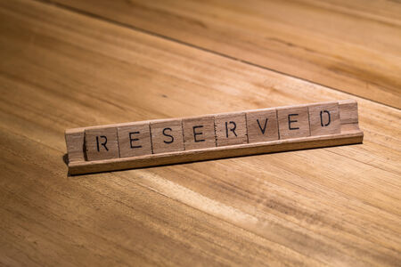 reserved sign: wooden reserved sign in restaurant Stock Photo