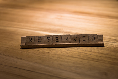 reserved: wooden reserved sign in restaurant Stock Photo