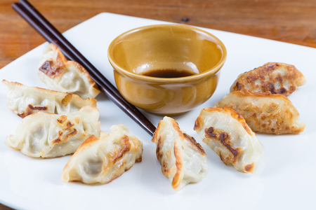 gyoza: Fresh Gyoza with sauce Stock Photo