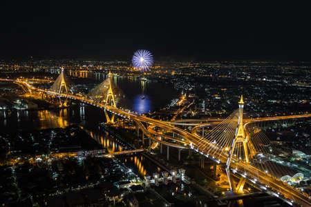 Night Scene at Bhumibol Bridge with fireworks in Bangkok photo
