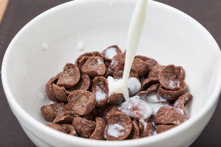 pouring milk: pouring milk into cereal