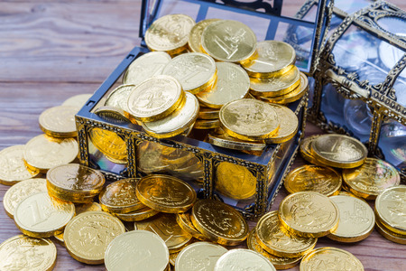 treasure chest: chocolate coin in chest Stock Photo