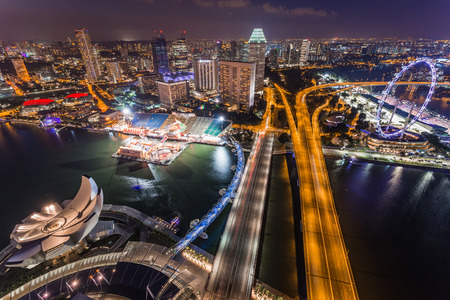 singapore cityscape: SINGAPORE - FEBRUARY 27, 2015: aerial view of Benjamin Sheares bridge, Helix bridge and Singapore Flyer at Marina Bay, Singapore. Marina Bay is one of the most famous tourist attraction in Singapore.