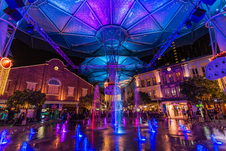 SINGAPORE - FEBRUARY 28, 2015: Night scene of colourful buildings at Clarke Quay. Clarke Quay is a historical riverside quay in Singapore.