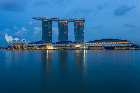 marina bay sand: SINGAPORE - MARCH 2, 2015: Sunrise scene at Marina Bay Sands. Marina Bay Sand is one of the most famous tourist attraction in Singapore.