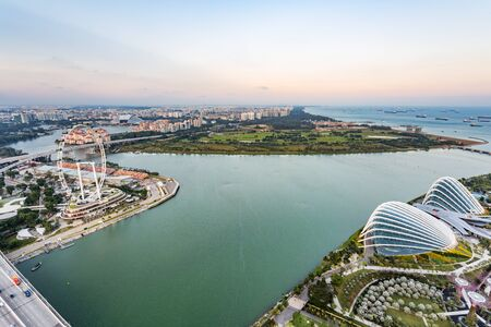 singapore: SINGAPORE - FEBRUARY 27, 2015: aerial view of Garden by the Bay and Singapore Flyer. Garden by the Bay and Singapore Flyer are the famous tourist attraction in Singapore.