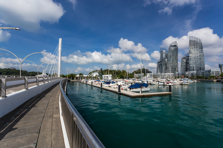 condominium complex: SINGAPORE - MARCH 1, 2015: Day scene at Reflections at Keppel bay and Yatch pier. Reflections at Keppel bay is the luxury waterfront residential complex designed by Daniel Libeskind. Editorial