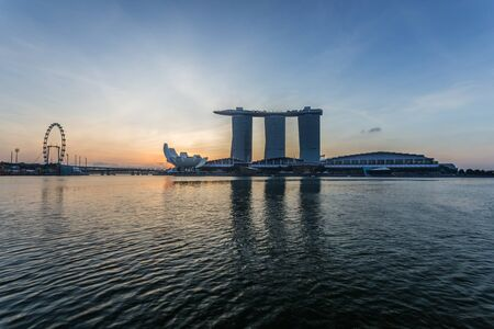 marina bay sand: SINGAPORE - MARCH 1, 2015: Sunrise scene at Marina Bay Sands. Marina Bay Sand is one of the most famous tourist attraction in Singapore.