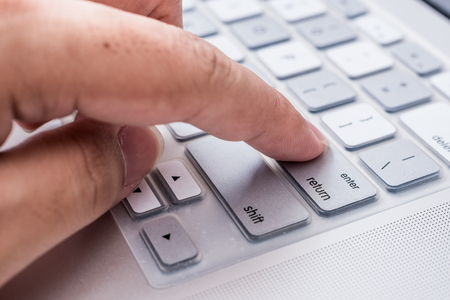 press button: hand press enter button on computer
