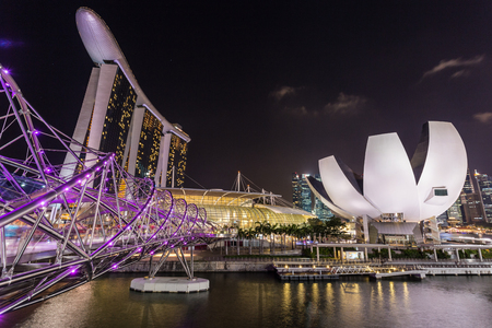 marina bay sand: SINGAPORE - FEBRUARY 27, 2015: Night scene at Marina Bay Sands. Marina Bay Sand is one of the most famous tourist attraction in Singapore.