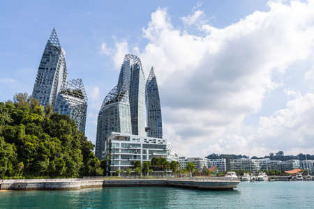 condominium complex: SINGAPORE - MARCH 1, 2015: Day scene at Reflections at Keppel bay, Singapore. Reflections at Keppel bay is the luxury waterfront residential complex designed by Daniel Libeskind. Editorial