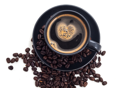 crema: black coffee cup with heart shape crema and coffee beans top view Stock Photo