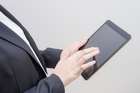 use: hand use computer tablet Stock Photo