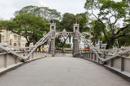SINGAPORE - MARCH 2, 2015: Day scene of Cavenagh Bridge, Singapore. Cavenagh Bridge is one of the oldest bridge in Singapore that exists in its original form..