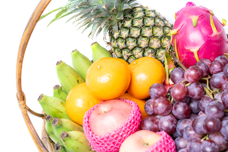 various fruits including apple, pineapple, grape, orange, pitaya and banana.