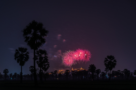 Beautiful firework over Phra Nakhon Khiri hilltop Palace or Khaowang with decorative lighting at Phetchaburi, Thailand