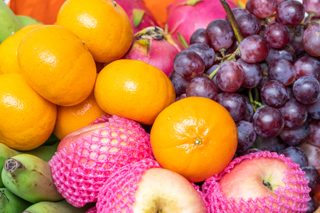 various fruits including apple, grape, orange, pitaya and banana. Stock Photo