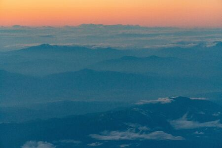 aerial of cloud and mountain in the evening Stock Photo