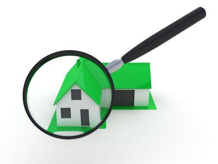 ortseingangsschild: Wenig grünes Haus unter Lupe Lizenzfreie Bilder