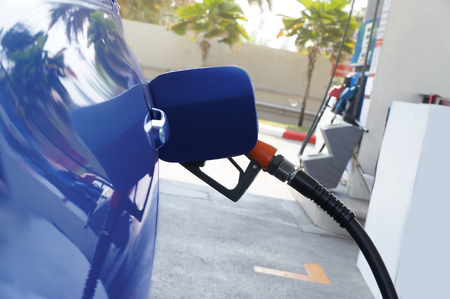 fuelling pump: Fuel nozzle to refill fuel in car. - Concept energy, Stock Photo