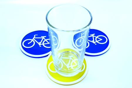 Glass on Coaster bicycle symbol isolated on white background photo