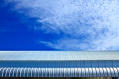 Metalic Facade, roof aluminium factory on blue sky photo