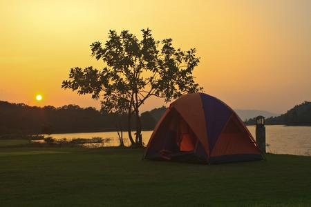 camping ground and sunset at lake Camping at kaeng krachan Dam, Phetchaburi, Thailand