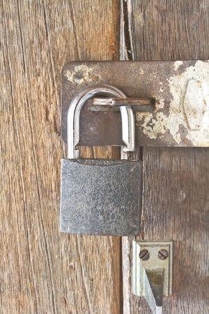 old padlock on an old wooden door photo