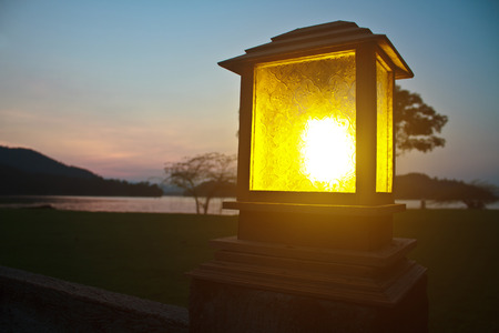 lighting pole and sunset at camping ground kaeng krachan Dam, Phetchaburi, Thailand photo