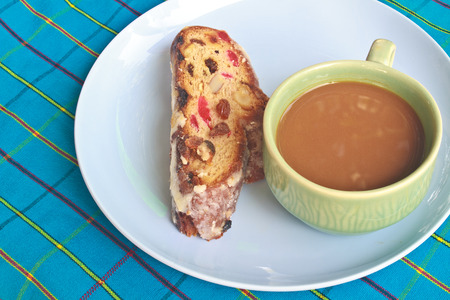 Fruitcake with raisin and Seasoning on table, with hot coffee photo