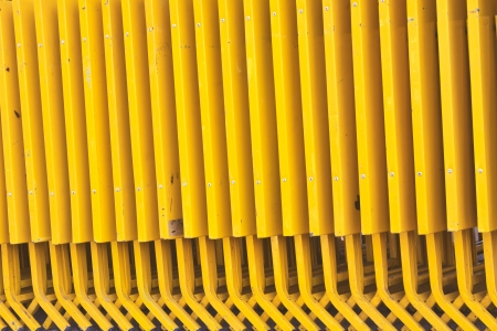 Yellow Folding table made of steel in a row photo