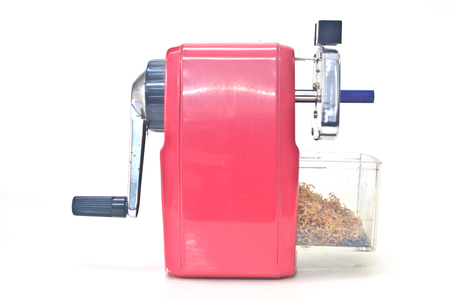 red pencil sharpener on white background photo