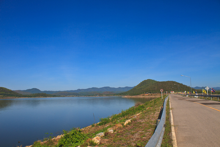asphalt road and blue sky on top of DAM photo