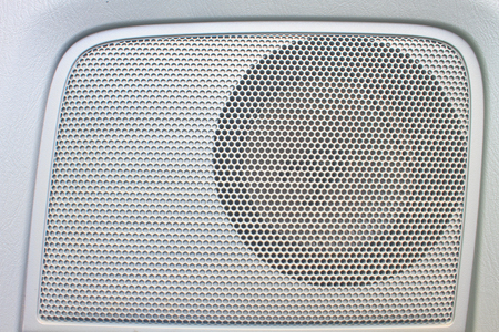 single songs: close up Car speaker on door panel and texture