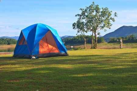 Camping in the wilderness, tent on campground in morning