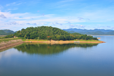 Kaeng Krachan Dam, Thailand, asphalt road and blue sky on top of DAM  photo