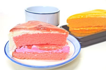 Dessert Orange Cheesecake with Strawberry cheesecake in plate on background photo