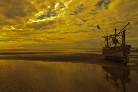 Fishing boat on the beach and sunset  photo