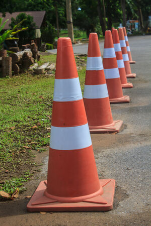 traffic warning cone in row to separate route in parking area photo