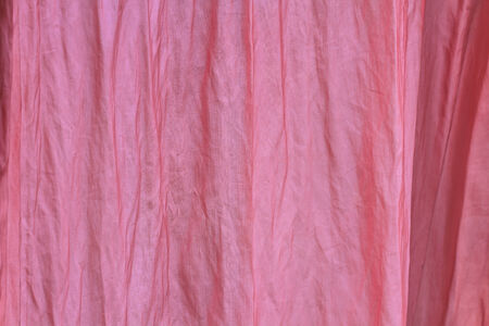 draped cloth: pink curtain on window, abstract background and decoration