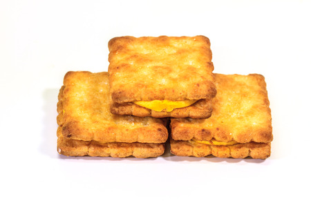 Sandwich biscuits with cream on white background photo