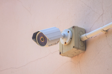 nightvision: CCTV Camera on the white  old wall