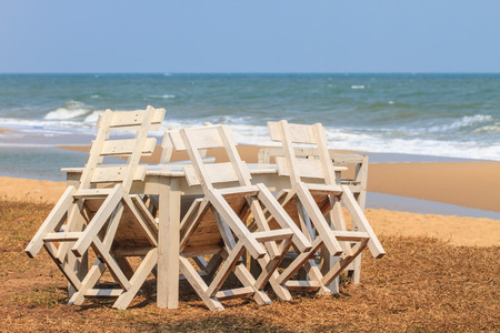 wood  bench with sea in the background photo