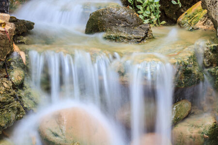Close up Small waterfall in a garden photo