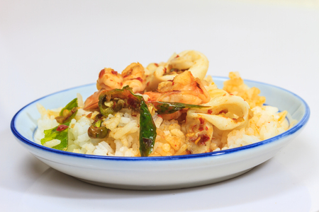 Squid and shrimp fried with chili paste thai style food photo