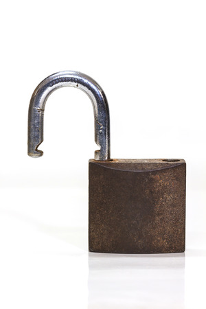 Close up on locked padlock over white background photo