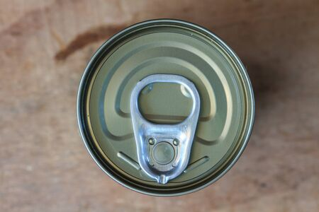inhibited: Closeup shot from the pull ring on a beverage can, opened aluminum can
