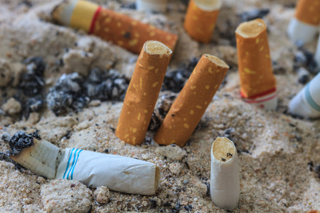 close up of Cigarettes butt in ashtray photo